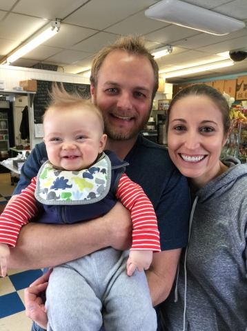 Us with a happy baby. To be clear..not our child.